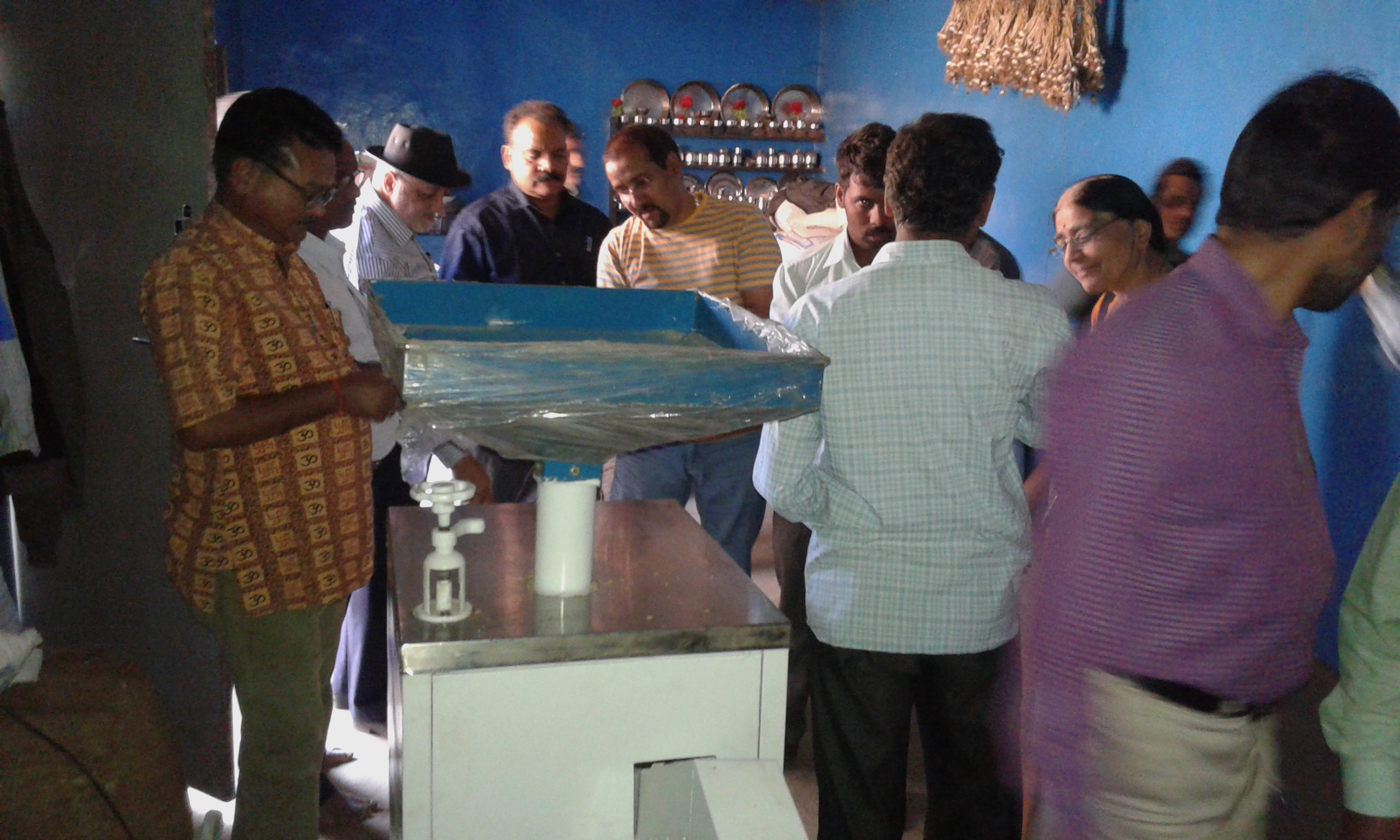 Dr.Sunil Agarwal and experts team discussing functioning of dehusking mill developed by Vigyan Ashram.